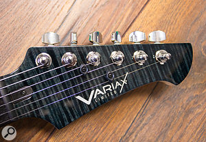 Both the body and headstock of the Onyx model usually appear almost black, but from certain angles and in the right light, the decorative pattern is revealed.