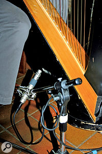 The harp mic was placed six to eight inches from the soundhole. This is quite low on the harp and it is important to place the mic where it won't easily get knocked by the performer's feet.