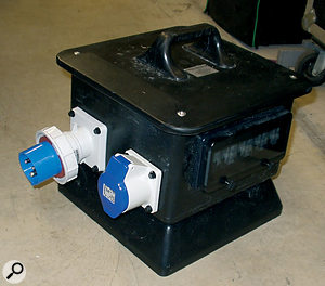 A professionally made distribution box with four 16-Amp outputs, all RCD protected, for limited outdoor use.