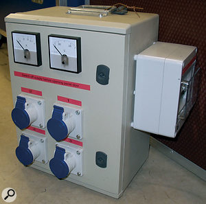 A professionally made distribution box with meters to indicate AC mains voltage and current.