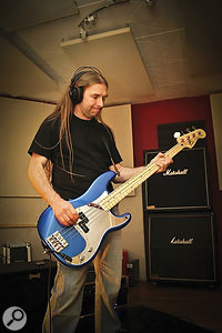 Damnation's Hammer bassist Jamie monitoring the click via headphones during rehearsals focussed on tempo mapping.