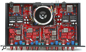 A look inside the Mini Massive reveals a high-quality PCB covered in premium, audio-grade components, along with four small daughter circuit-boards that carry additional relays and a few passive surface-mount devices.
