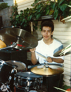 At the age of 16, playing the drums.
