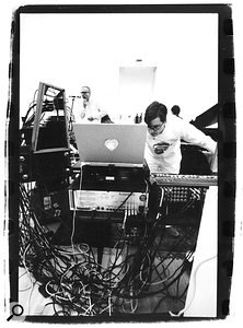 Matmos recently rebuilt their studio in a San Francisco arts centre, creating an installation with which members of the audience could interact. Drew Daniel (foreground) tends to their Powerbook and Emu sampler, while Martin Schmidt vocalises.