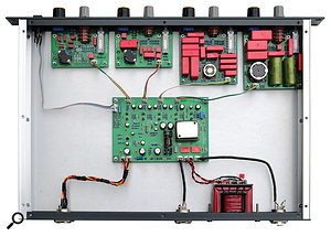 A shot of the LCPQ 4040's internals, showing lovely Wima capacitors and multitap inductor cores on all four filter modules, mounted behind front-panel knobs. Transistor gain stages and bypass relays are on a  central PCB with the input transformer. The output transformer is on the rear panel with a  Zobel network across the terminals.