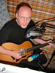 Here, both mics have a figure-of-eight pattern. The side rejection is being put to good effect so that the guitar mic rejects most of the vocal and vice-versa, giving better separation than you would get with cardioid or omni mics. However, given that they also pick up from the rear, you need to be particularly careful to avoid sounds hitting the rear of the mic.