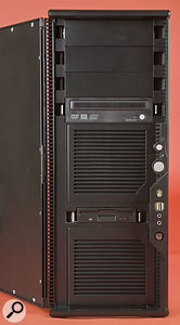 The magnetically sealed door opens to provide access to the drives and front-panel ports.
