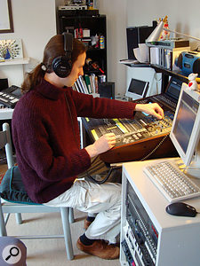 Mike tweaking the controls at the Yamaha digital desk that forms the heart of David's studio.