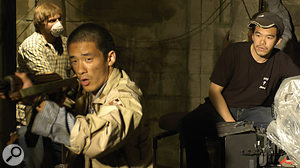 Allan Tsao (right), director of Ghost Soldier, working on the custom-built set of the film.