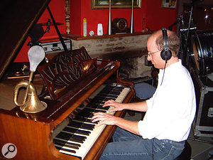 In-house orchestrator and conductor Jonny Williams overdubs a piano part.