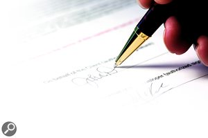 Off The Record: pen signature on paper contract.