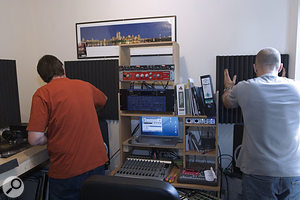 In order to tidy up the monitoring system's stereo imaging, Paul and Dave used contact adhesive to glue acoustic foam panels around the side walls of the room, thereby reducing acoustic reflections reaching the mixing position.