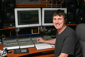 Paul White with two Apple monitors and Mackie controllers.