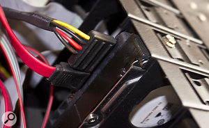 With just a couple of connectors and screws to undo and reconnect, physically transferring a hard drive to a  new machine is easy.
