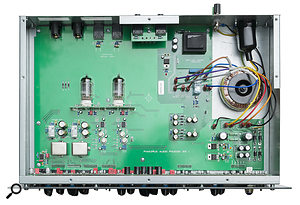 A view of the inside of the Phusion, with the two dual-triode valves for the RCA-style preamp stage clearly visible in the centre, with the input transformers below and to the left. Most of the remaining electronics are mounted on the vertical PCB directly behind the front-panel controls. The black cylinders sticking out from the top of the front board are the inductors for the passive EQ stage.