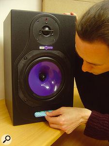Stuffing ported monitors (HHB Circle 5s in this case) with socks or fabric will attenuate low frequencies emitting from the cabinets. This will make their output bass-light, but you'll be able to judge the low-mid frequencies better as a result.