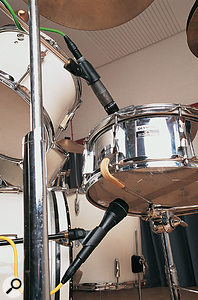 If you're going to 'over-and-under' mike a snare, remember to switch one of the mics out of phase.