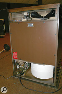 A rear view of the Leslie 122XB cabinet, with panels removed to reveal the treble horns (top) and foam bass rotor (bottom) responsible for the distinctive Leslie sound.