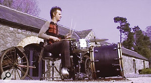 A less successful experiment: Dominic Howard plays drums outdoors in the Grouse Lodge courtyard.