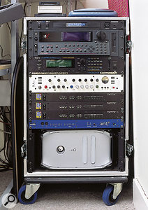 The duo's mobile rack contains (from top) Emu E4X sampler, Roland JV2080 sound module, TLA Ivory voice channel, Digidesign 882 I/O interfaces (x3), Emagic AMT8 MIDI interface and Apple G4 Mac computer.
