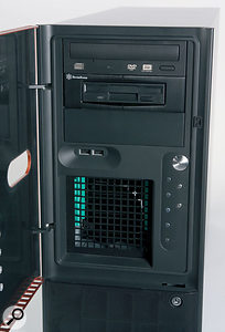 The DVD-RW and floppy drives are located behind the orange door on the front panel.