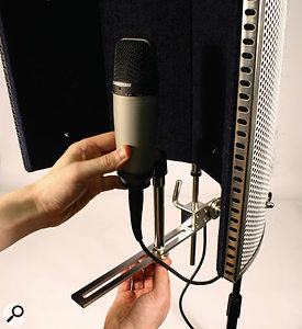 The Reflexion Filter is designed to attach to the same stand as your vocal mic.