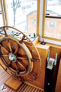 The wheelhouse overlooks the entrance to the studio rooms in the belly of the barge.