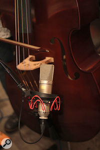 A Neumann U87 was used on the double bass, along with the output of an in-built pickup.