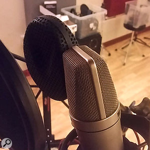 The vocal part was tracked using two mics — a  'safe-bet' Neumann U87 (nearest) and Coles 4038 ribbon mic. Unusually, both mics' signals would end up being blended together to create the final vocal sound.