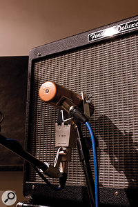 Two guitar-cab mics were used, both to shape the sound and to allow the instrument to be treated as a stereo source at mixdown.