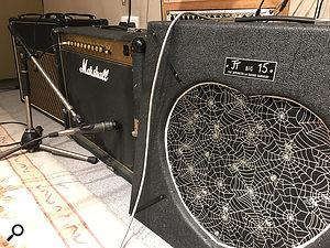 To capture Rossi's guitar sound, a  Shure SM57 facing the centre of the cone of a  Marshall JCM900 combo made the biggest contribution, but this was mixed with a  more distant Neumann KM183 omni room mic set up at head height.