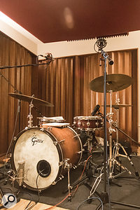Just as important as how the drums were miked — which was fairly conventional — was how the instrument itself was set up. In this case, toms other than the floor tom were removed, and the kick was tuned down, and its resonant head was damped to help achieve a  dryer, tighter sound.