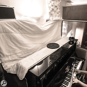 A familiar SOS studio accessory: a humble polyester duvet to reduce the cymbal spill into the rear piano mics.