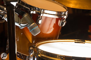 Here you can see three of the four snare-drum microphones that were used: a Shure Beta 56 dynamic over the drum; a Shure KSM132 small-diaphragm condenser under the drum; and an ADK A7 large-diaphragm condenser between the kick and snare to capture additional shell tone and rattle.
