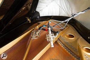 The mics inside the piano had been large-diaphragm cardioids on the previous session, but this time Mike replaced those with small-diaphragm omnis, which gave a  clearer and more natural timbre.