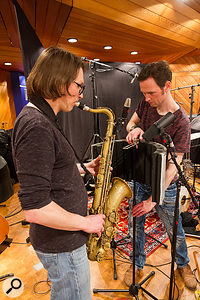 Firing the saxophone's bell directly into an sE Electronics Reflexion Filter significantly reduced the levels of spill it generated on other instruments' mics.