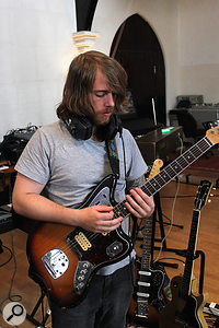 Two amps were used on the electric guitar during the main band session. Both were miked in similar fashion, with a  Shure SM57 alongside a  Royer R121, and placed in isolation booths. The Marshall rig pictured here was also used in the main live space for overdubs, where it was joined by a  slightly more distant Coles 4038 mic to fill out the sound.