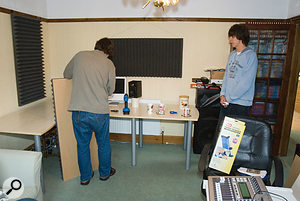 The desk, which had been in the corner, was rotated so that the mixing position faced the middle of the shorter wall, and Auralex acoustic foam was used to improve acoustics and tighten the stereo imaging. We glued the foam onto panels, so that no damage was done to the walls and the panels could be moved as necessary.