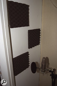 A few thinner pieces of foam were placed on the wall behind the singing position to further reduce boxiness.