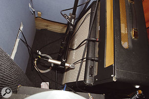 Turning the guitar cabinet round to face the absorbent acoustic treatment on the studio wall significantly reduced the acoustic spill into the drum mics, and a small gap left between the speaker and the wall allowed an AKG C1000 to be positioned for a very respectable recorded sound.