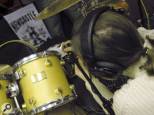 Mike adjusts the snare mic to try to emphasise attack without capturing excessive ringing.