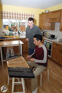 The bright ambience of Li's kitchen was ideal for recording Li's traditional yangqin.