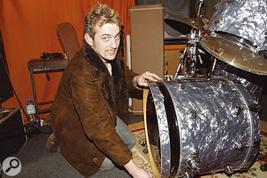 The hole in the front of the kick drum's front head was too small to allow a suitable mic position, so it was removed.
