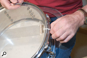 Before even touching the mics, Paul was able to make a large difference to the recorded sound of Jon's kick drum by simply whipping off the front head and inserting a blanket for damping. The snare wires were also causing trouble, because they were connected with string rather than the correct plastic tape, so it was suggested that this be fixed to improve the snare sound.