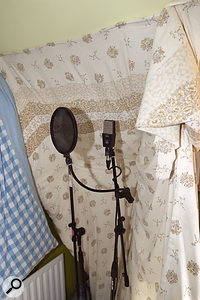 This is the vocal recording setup Tony had been using. Paul & Hugh recommended that he face the mic back into the padded corner, rather than into the room, in order to reduce the amount of room sound captured.
