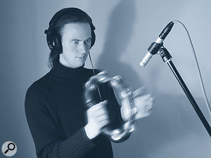 Sounding Off: Mike Senior with tambourine and microphone.