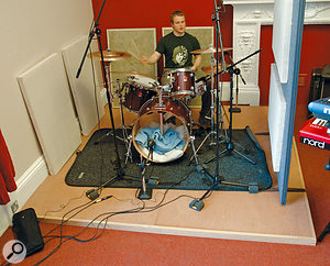 A less intrusive alternative to constructing a full floating floor is to create something like this drum riser. Of course, playing acoustic drums at home may not be a good idea if noise is a problem, but the same principle can reduce mechanical noise transmission through wooden floors from other instruments, including guitar amps.