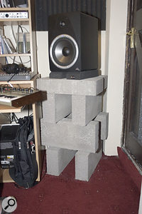 Dave had improvised speaker stands using piles of concrete building blocks. However, his original design (above) was rather unstable, so Paul rearranged it into this more stable configuration, and added some Auralex Mo Pad foam isolation pads for good measure.