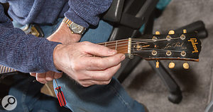 Paul adjusts the truss rod on one of Graham's vintage Gibson guitars.