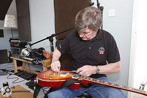 Paul White has a word with one of Paul Allen's guitars...